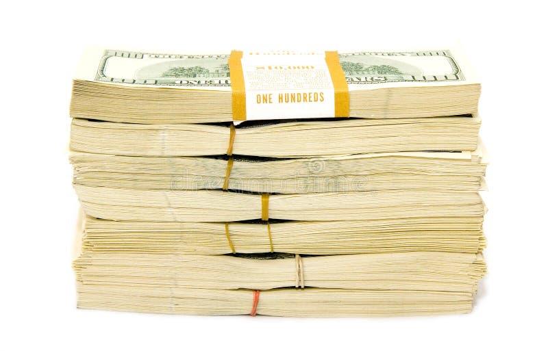 Many big paks of dollars over white ($70 000) royalty free stock photos