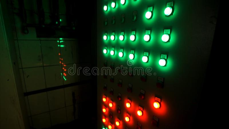 Many big red and green buttons on the industrial board at the factory. Stock footage. Industrial machine`s control panel stock photo