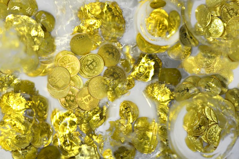 Bitcoin crashing in water royalty free stock photos