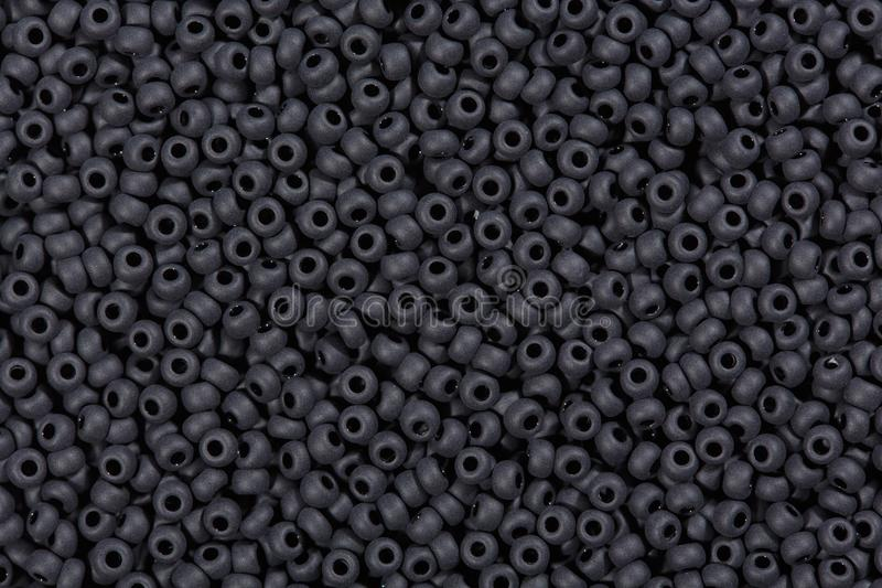 Many black glass beads, background. stock photos