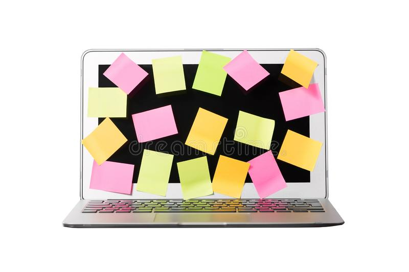 Many blank sticky notes covering a laptop screen isolated white background. Concept of deadlines or ideas.  stock photo