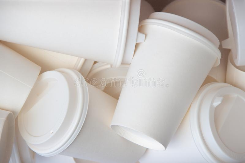 Many blank take away coffee cups white background mock up royalty free stock photo