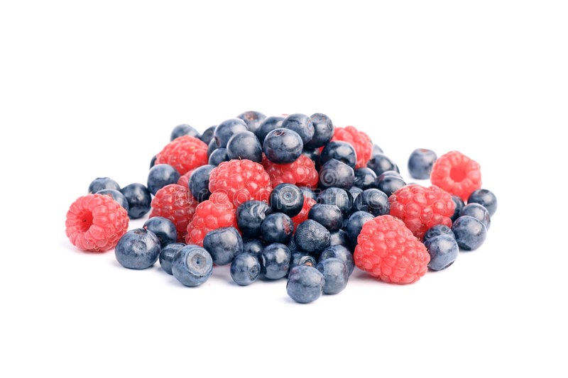 Many blueberries & raspberries royalty free stock photography