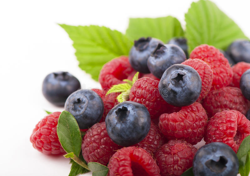 Many blueberries & raspberries. stock photography