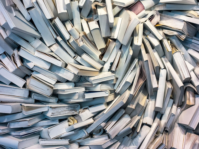 Many books in the chaos. Many books are completely messed up on a pile