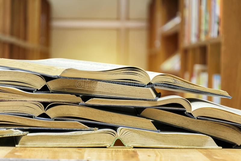 Many books are opened overlapping. Put on the table in the libra royalty free stock image