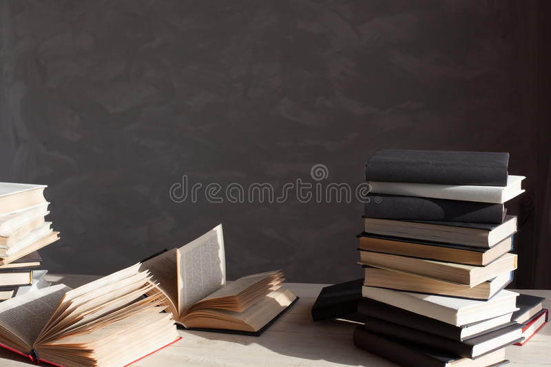 Many books are on the table at home in the library stock photo