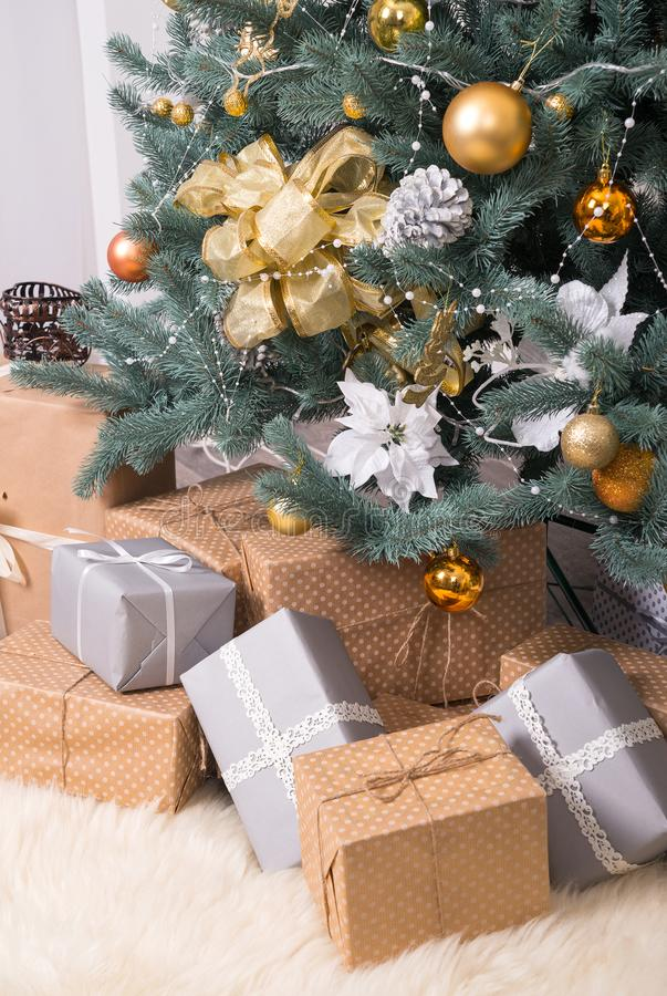 Many boxes with Christmas gifts under the Christmas tree stock images
