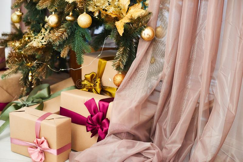 Many boxes with Christmas gifts under the Christmas tree royalty free stock photo