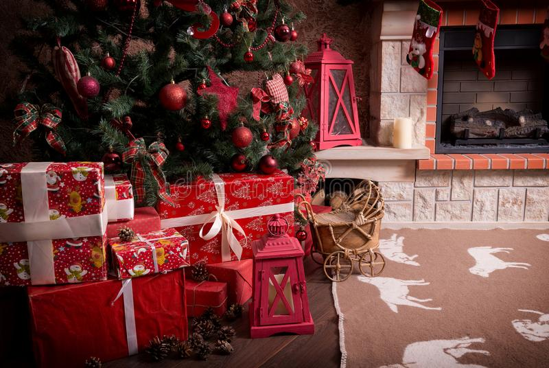 Many boxes with Christmas gifts under the Christmas tree stock photos