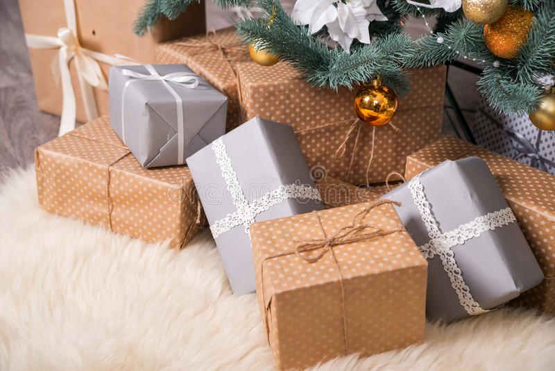 Many boxes with Christmas gifts under the Christmas tree stock image