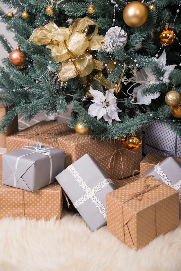 Many boxes with Christmas gifts under the Christmas tree stock photography
