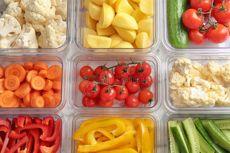 Many boxes with different raw vegetables. Closeup stock image