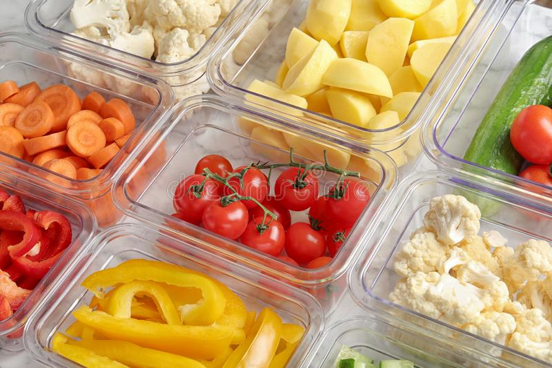 Many boxes with different raw vegetables. Closeup stock images