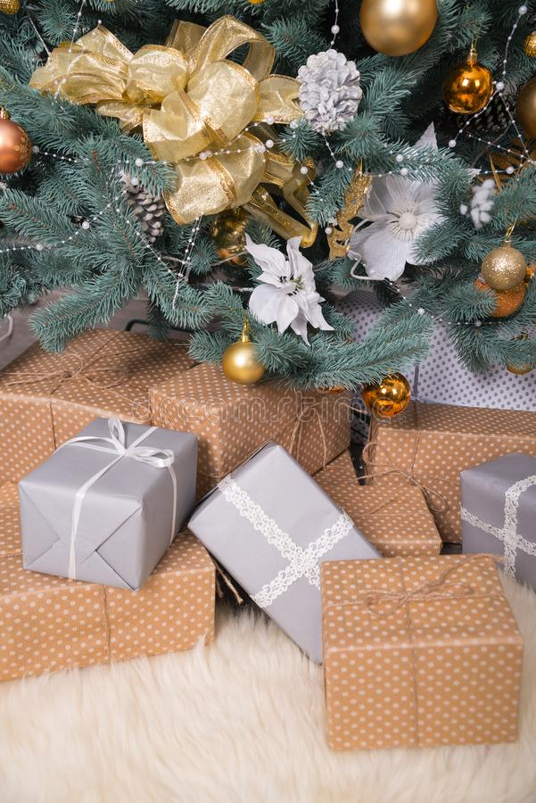 Many boxes with gifts under the Christmas tree stock photography