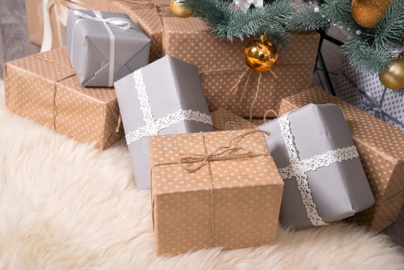 Many boxes with gifts under the Christmas tree royalty free stock photo