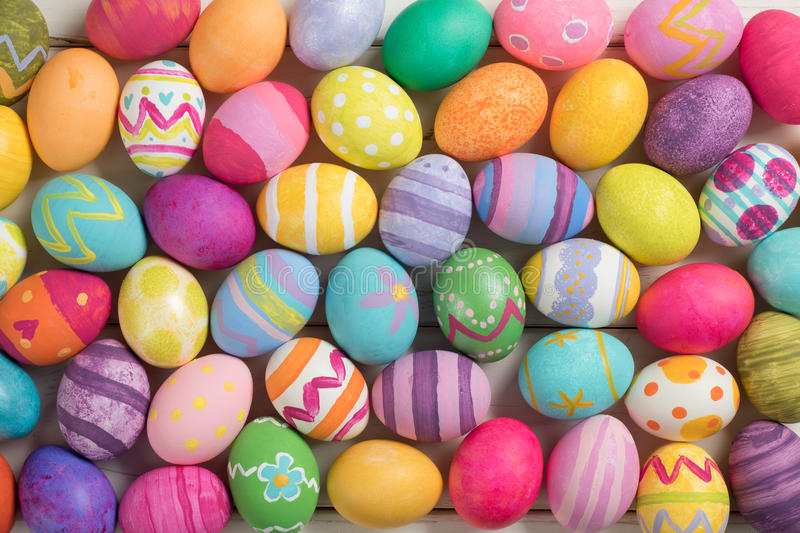 Many Bright and Colorful Easter Eggs Filling the Background. They are hand-painted or dyed. stock image