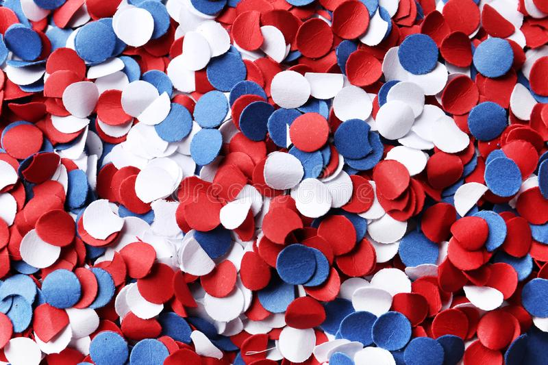 Many bright confetti as background. USA Independence Day. Many bright confetti as background, closeup. USA Independence Day royalty free stock photo