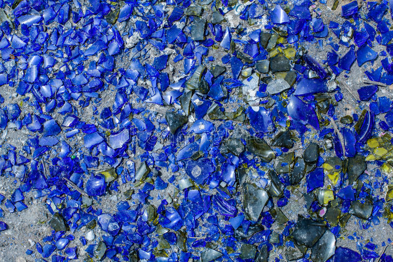 Many broken pieces of glass in blue royalty free stock photography