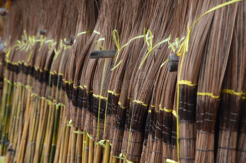 Many brooms make with coconut leaves royalty free stock photo