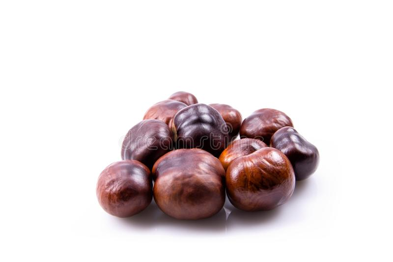 Many Brown Chestnuts - Isolated On White Background stock photography