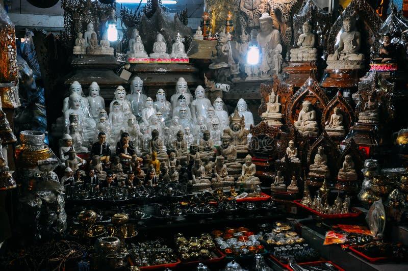 Many Buddha carvings and souvenirs in Mandalay. royalty free stock image