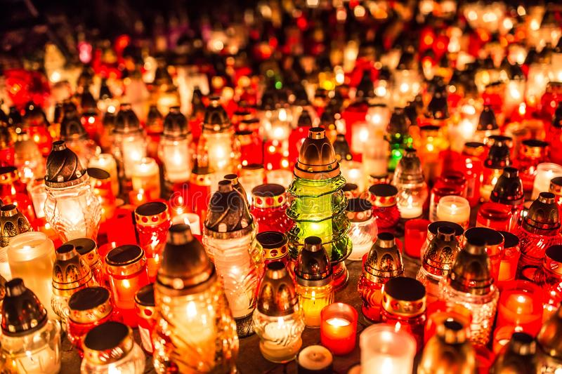 Many burning candles in the cemetery at night on the occasion so royalty free stock photos