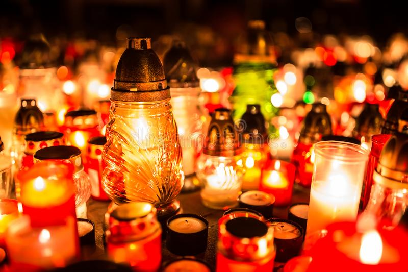 Many burning candles in the cemetery at night on the occasion so royalty free stock photo
