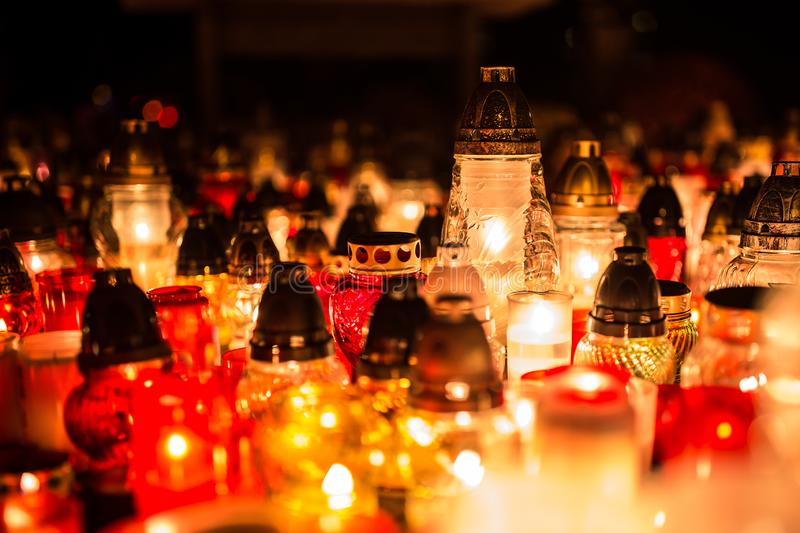 Many burning candles in the cemetery at night on the occasion so royalty free stock images