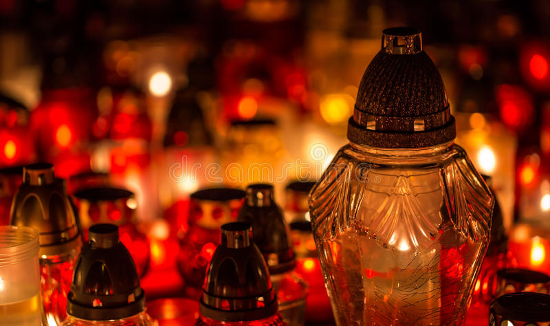 Many burning candles in the cemetery at night on the occasion memory of the deceased.Souls stock photo