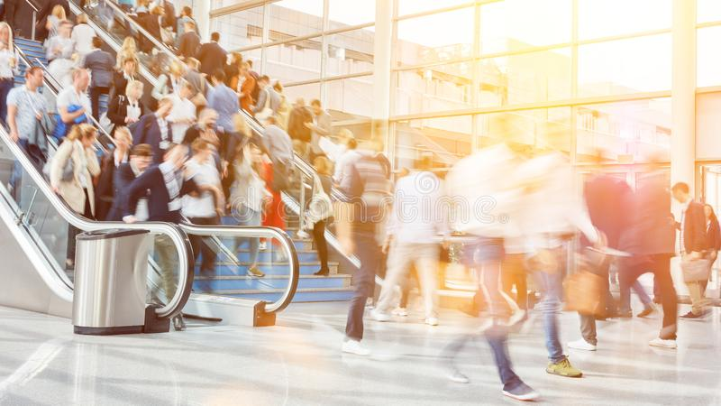 Many business people as a crowd at trade fair stock photography