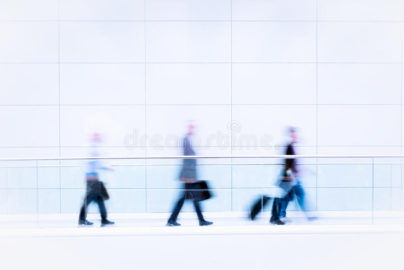 Download Many Business People In Blurred Motion Stock Photo - Image: 26880352