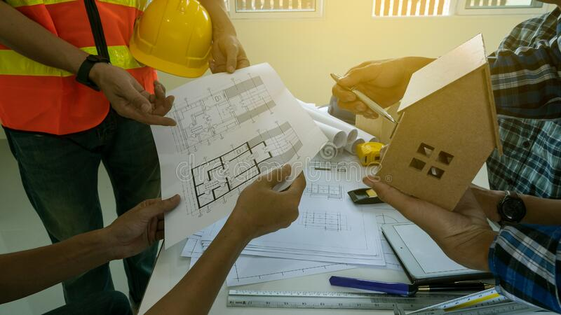 Many businessmen and construction engineers are scolding the house designs for building stock photography