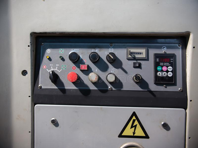 Many buttons on old large industrial printer royalty free stock photos