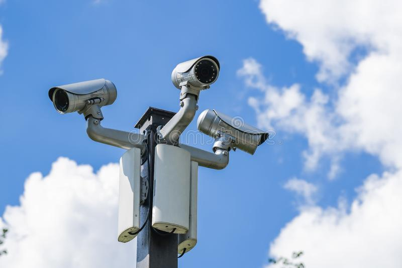Many cameras video surveillance on a pole against the sky.  royalty free stock photos