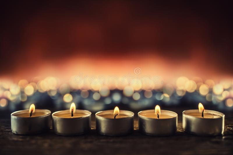 Many candles symolizing funeral religios christmas spa celebration birthday spirituality peace memorial or holiday burning stock photography
