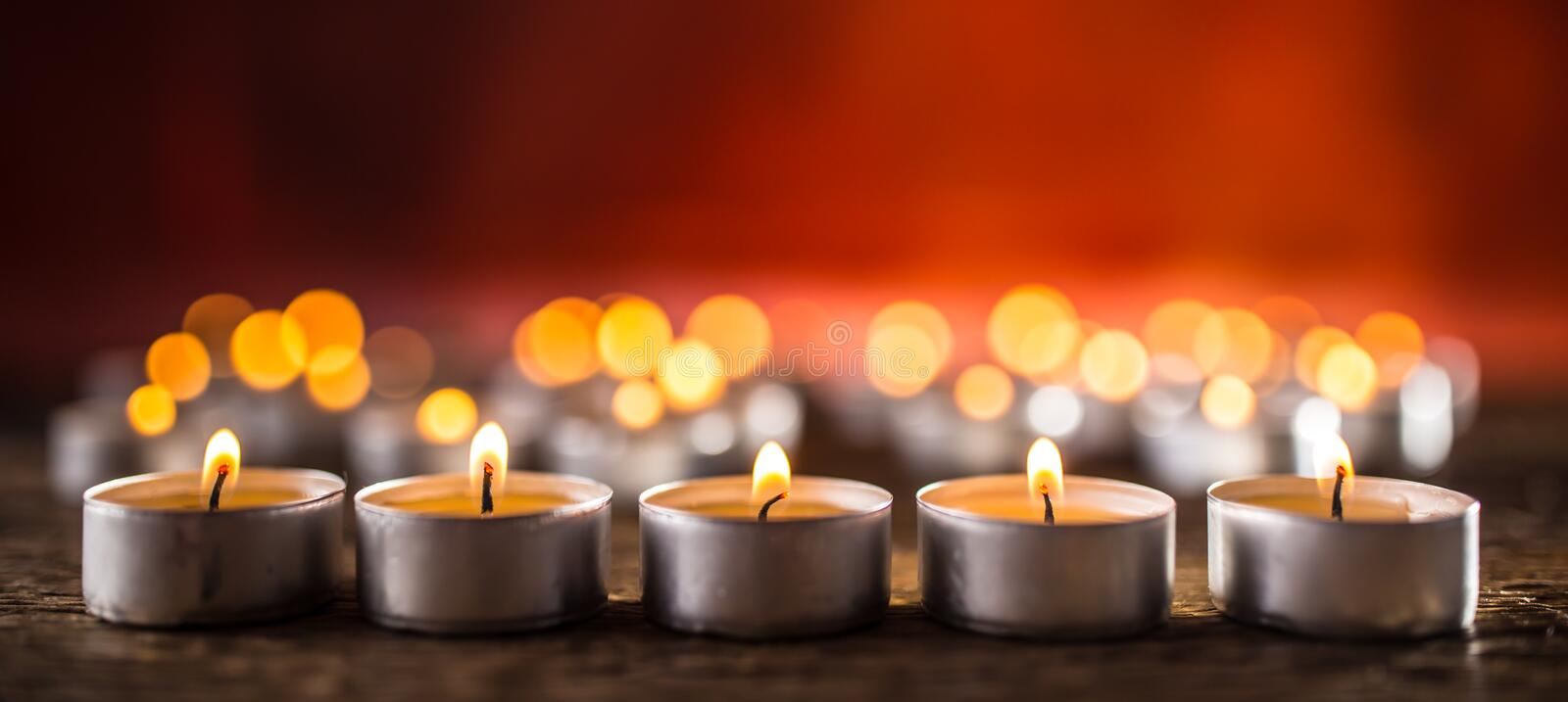 Many candles symolizing funeral religios christmas spa celebration birthday spirituality peace memorial or holiday burning royalty free stock photo
