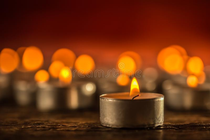 Many candles symolizing funeral religios christmas spa celebration birthday spirituality peace memorial or holiday burning royalty free stock photo