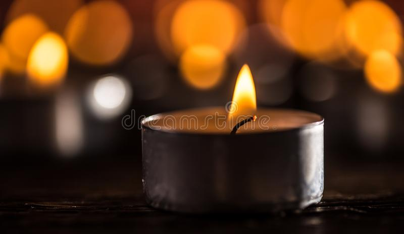 Many candles symolizing funeral religios christmas spa celebration birthday spirituality peace memorial or holiday burning. At night royalty free stock images