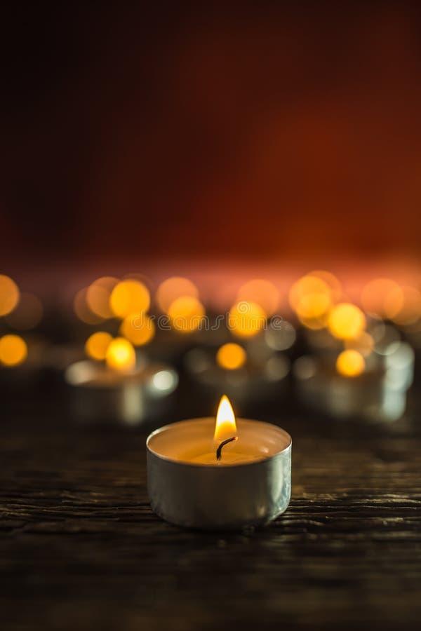 Many candles symolizing funeral religios christmas spa celebration birthday spirituality peace memorial or holiday burning stock photography