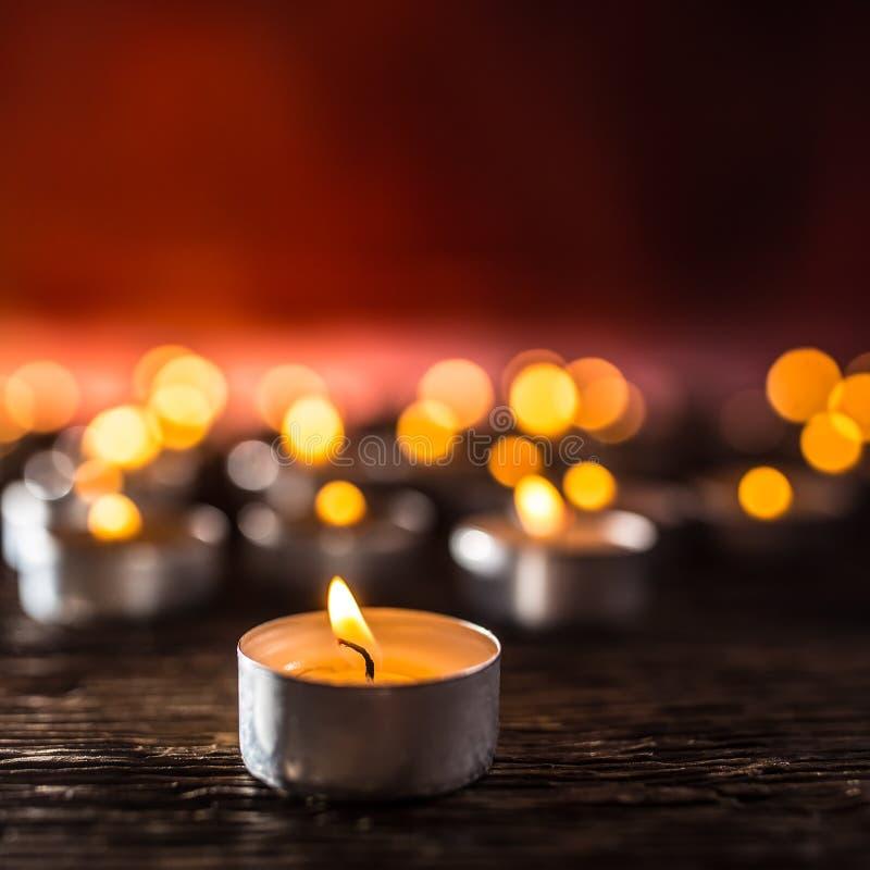 Many candles symolizing funeral religios christmas spa celebration birthday spirituality peace memorial or holiday burning stock image