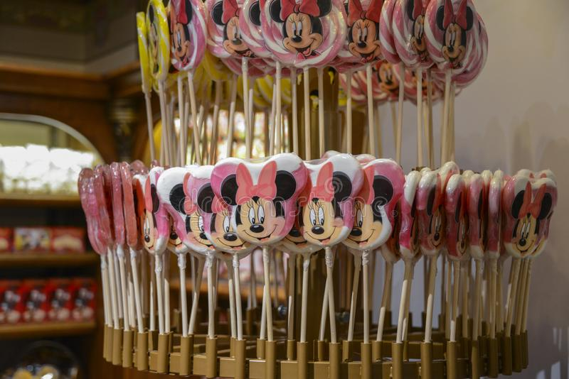 Many candy lollipops, with the face of the mouse Minnie, in Paris royalty free stock images