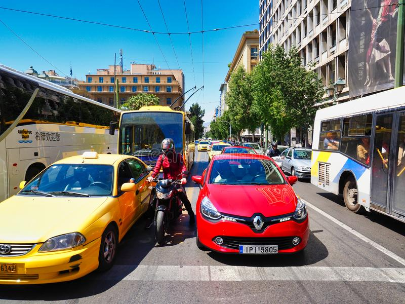 Heavy Traffic at Stop Lights, Central Athens, Greece. Many cars and buses, heavy traffic, at stop light on Stafdiou Stadium Street, Central Athens City, Greece royalty free stock image