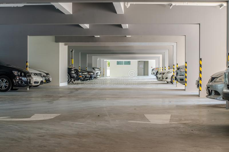 Many cars in parking garage interior building. royalty free stock image