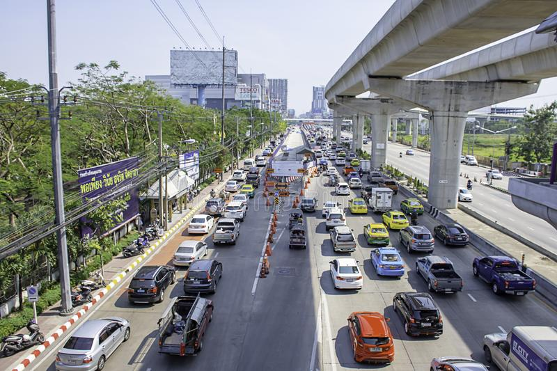 Many cars on the road and the road is being repaired at Rattanathibet Nonthaburi Province Government Center page in Thailand. stock images