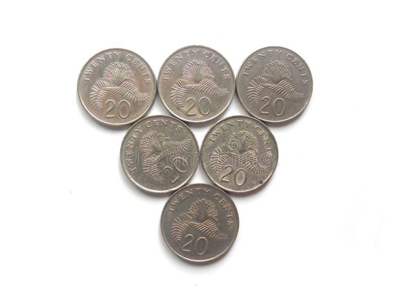 Many 20 cents Singapore coins. Many twenty cents Singapore coins on white background stock photography
