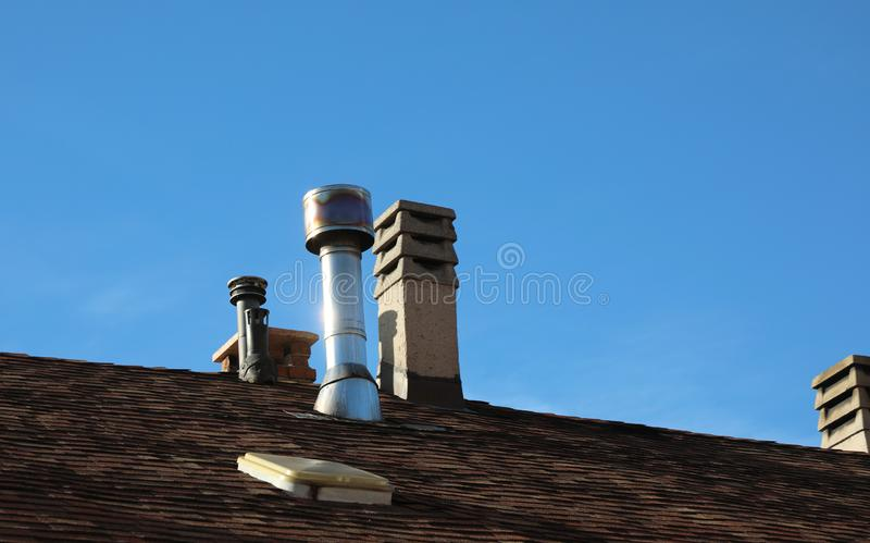 Many chimneys on the roof. Of the house stock photography