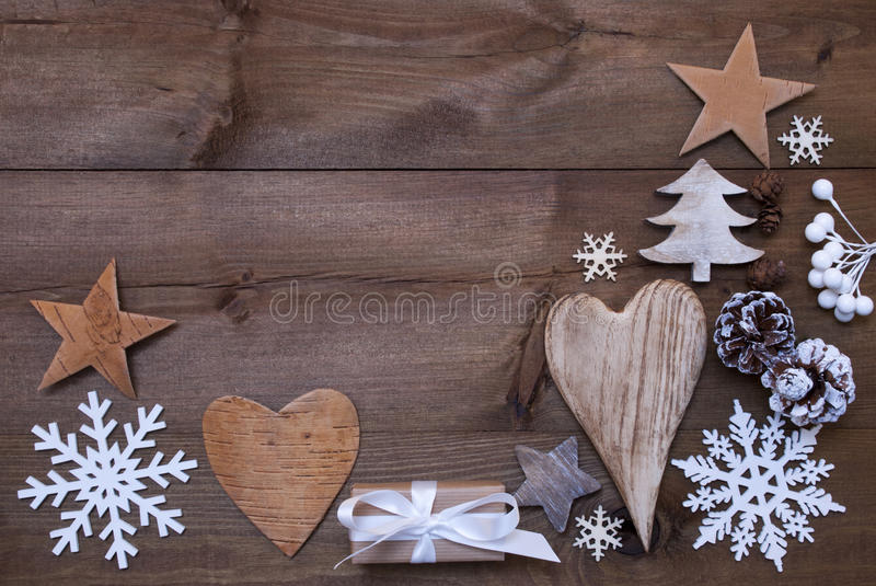 Many Christmas Decoration,Heart,Snowflakes,Tree,Present,Gift. Wooden Background With Many Christmas Decoration.Christmas Gift, Christmas Present, Heart royalty free stock photo
