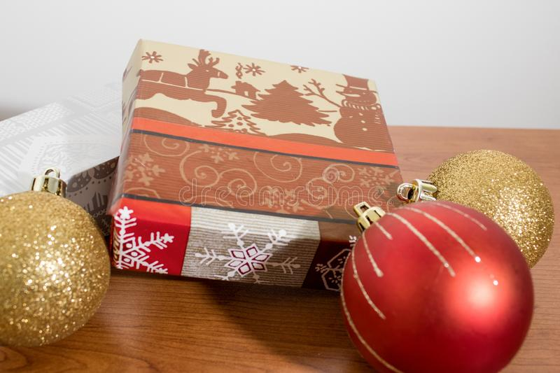 Many christmas gifts with decorations on a wood table royalty free stock images