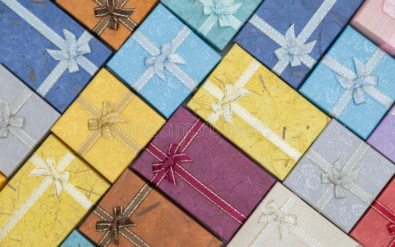 Many Christmas present or gift box background stock images